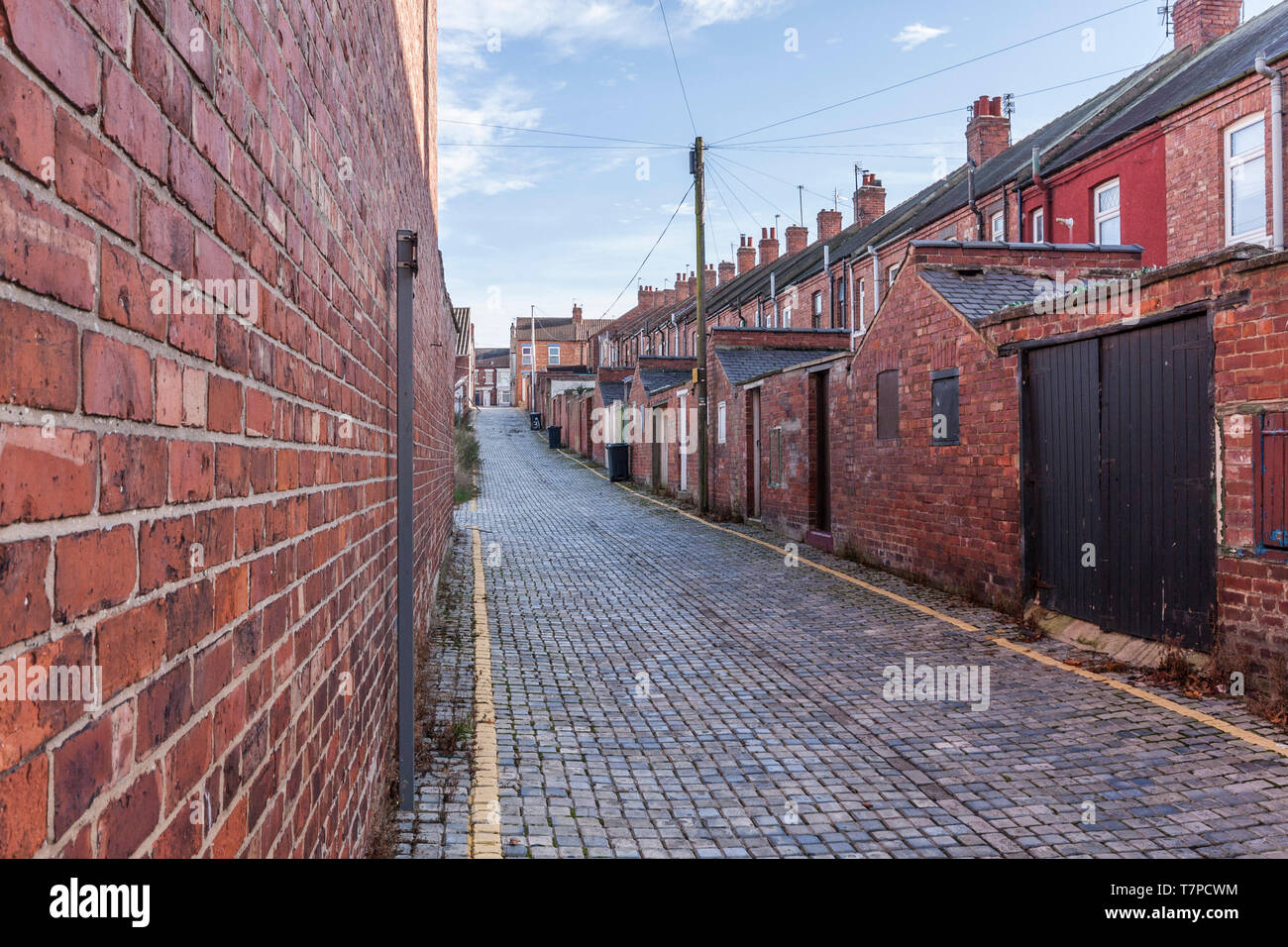 The rear alley of the terraced houses in Roslyn Street,Darlington,England,UK - Stock Image