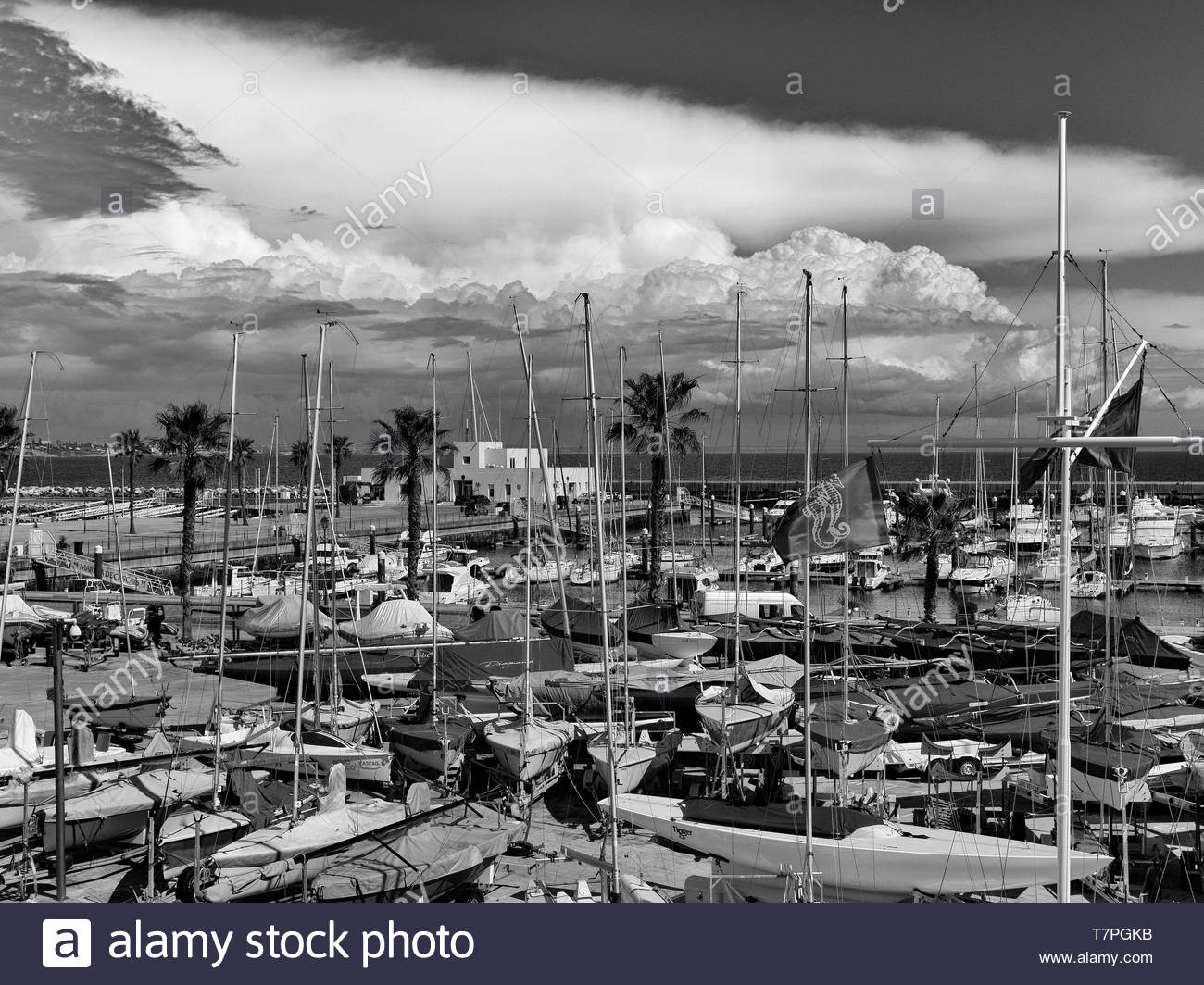 High contrast black and white storm clouds over Cascais Marina, Portugal Stock Photo
