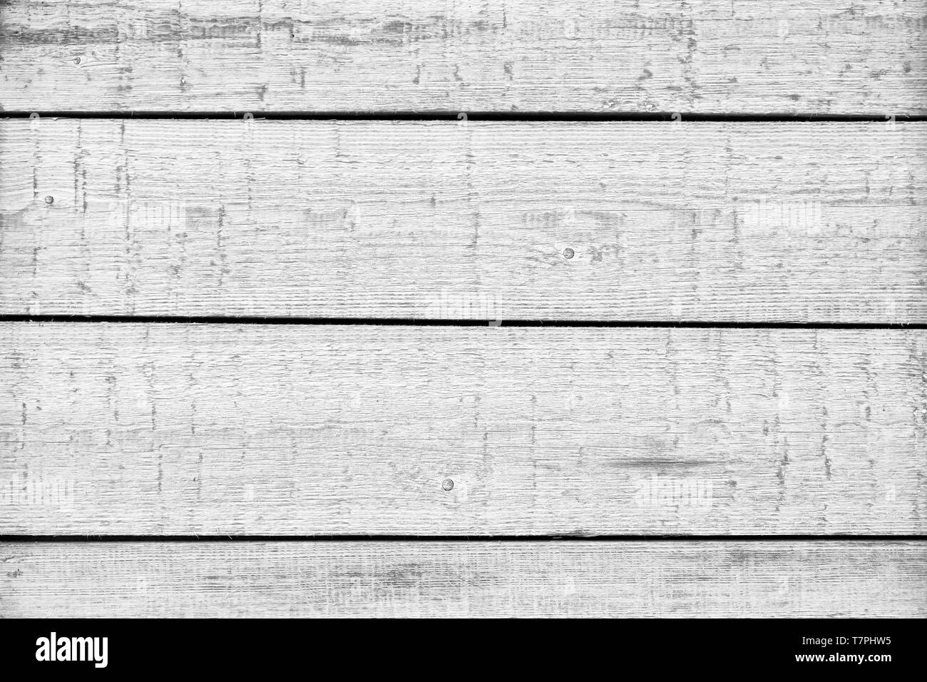 Wooden black and white background. Texture with an old, rustic, gray planks - Stock Image
