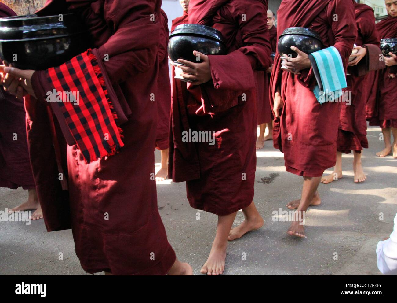 MANDALAY, MYANMAR - DECEMBER 18. 2015: Procession of Buddhist monks at Mahagandayon Monastery in the early morning Stock Photo