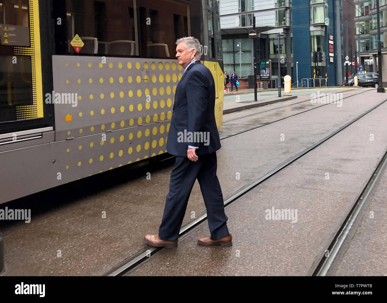 American Airlines pilot David Copeland, 63, leaves Minshull Street Crown Court in Manchester, after he has been spared jail after admitting being over the legal limit before a flight to the US. - Stock Image