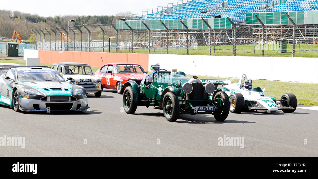 Historic Race Cars from Different eras, and different types, on a parade lap, during the 2019 Silverstone Classic Media Day. - Stock Image