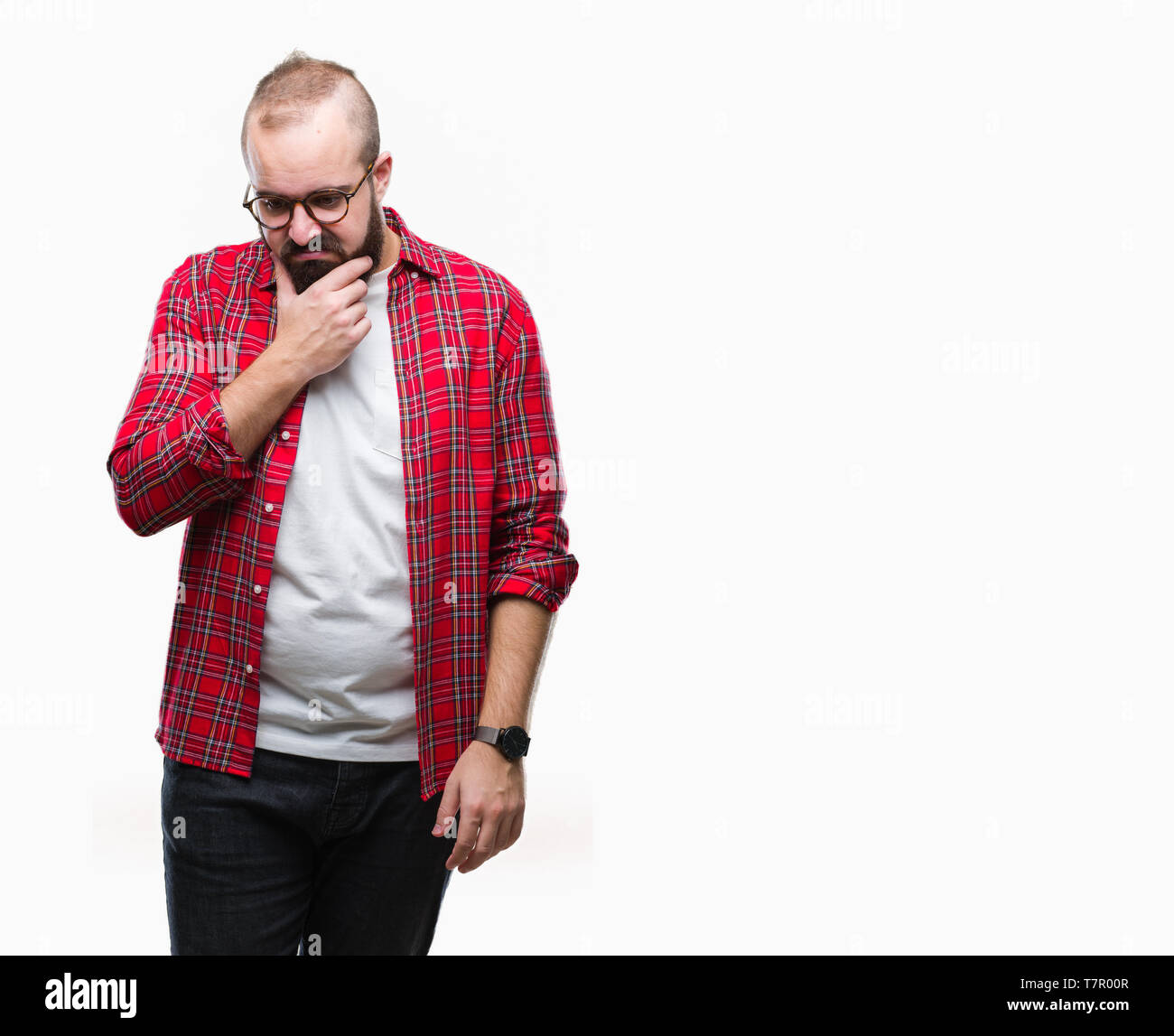 Young caucasian hipster man wearing glasses over isolated background thinking looking tired and bored with depression problems with crossed arms. Stock Photo