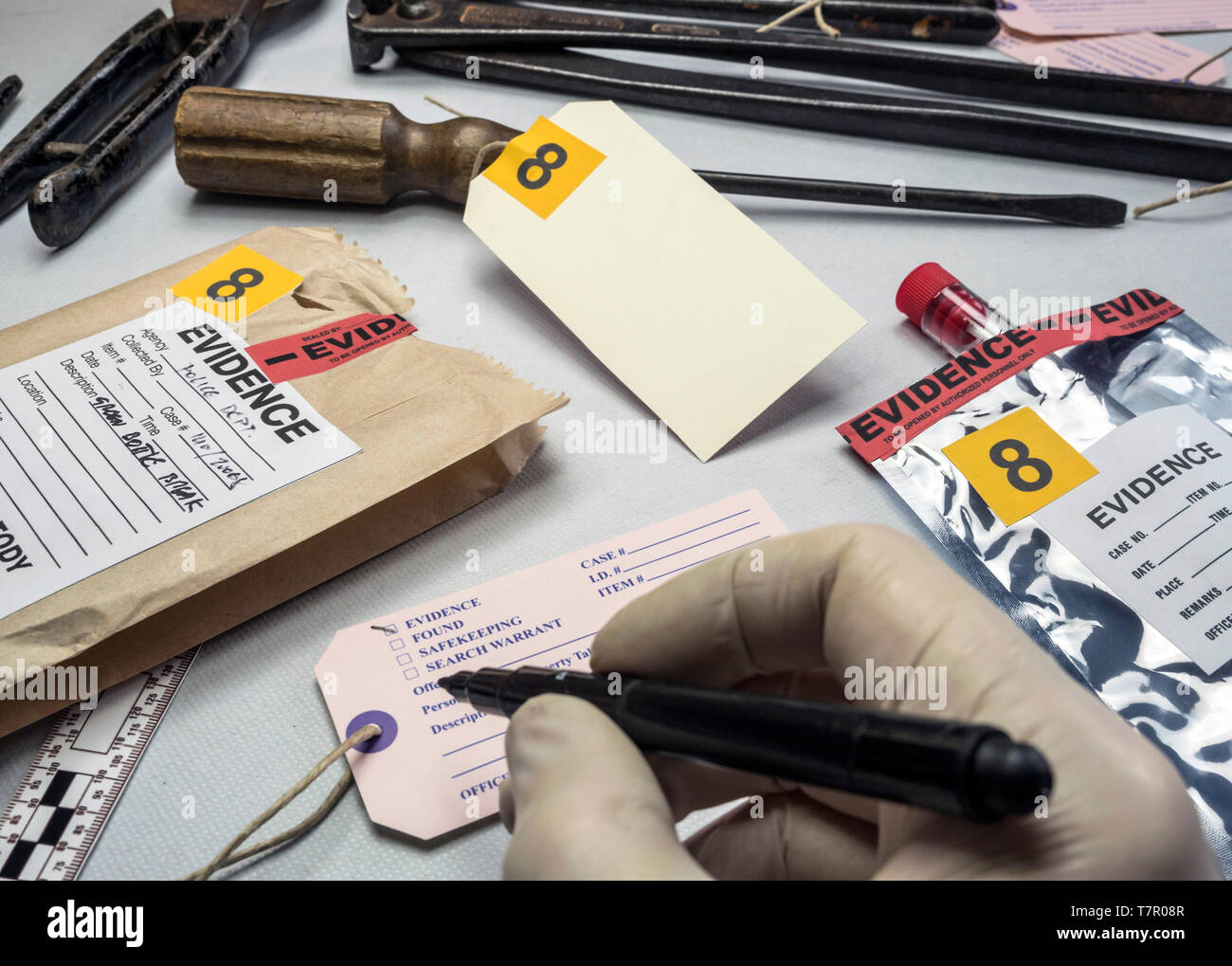 Police Expert Writes About Label Evidence Number Various Laboratory Tests Forensic Equipment Conceptual Image Stock Photo Alamy