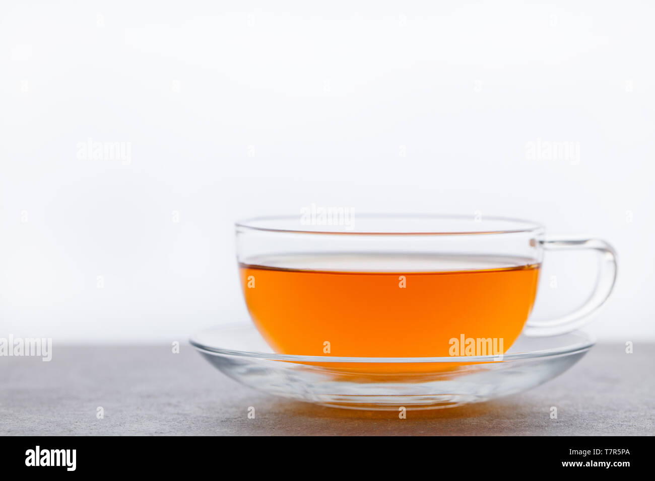 Tea in glass cup. Grey background. Copy space. Stock Photo