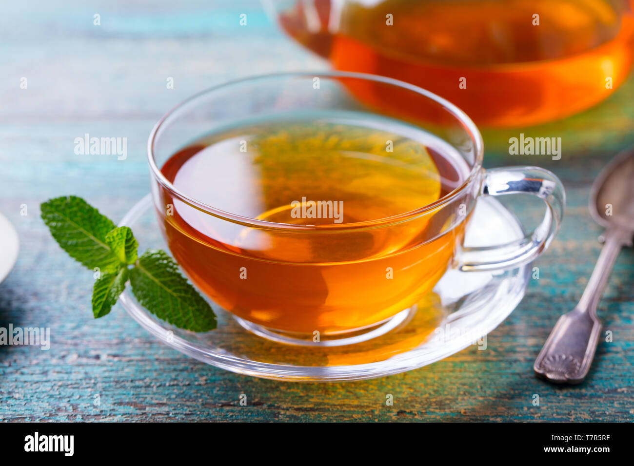 Tea cup with mint leaf and lemon. Close up. Stock Photo