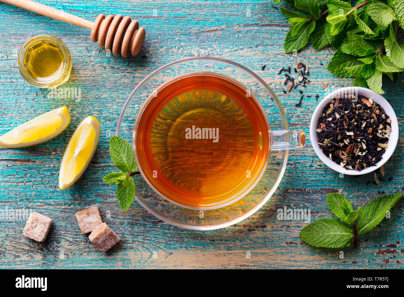 Tea cup with mint leaf and honey. Wooden background. Top view. Stock Photo