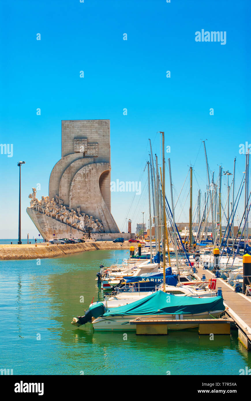 The harbour in Lisbon,Portugal with the Padrão dos Descobrimentos (Monument of Discoveries), in the background. - Stock Image