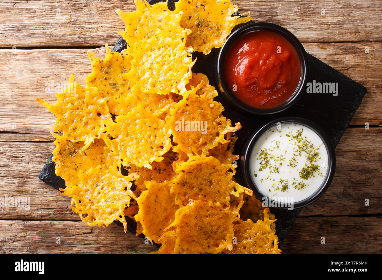 Delicious Appetizer Of Cheddar Cheese Chips With Herbs