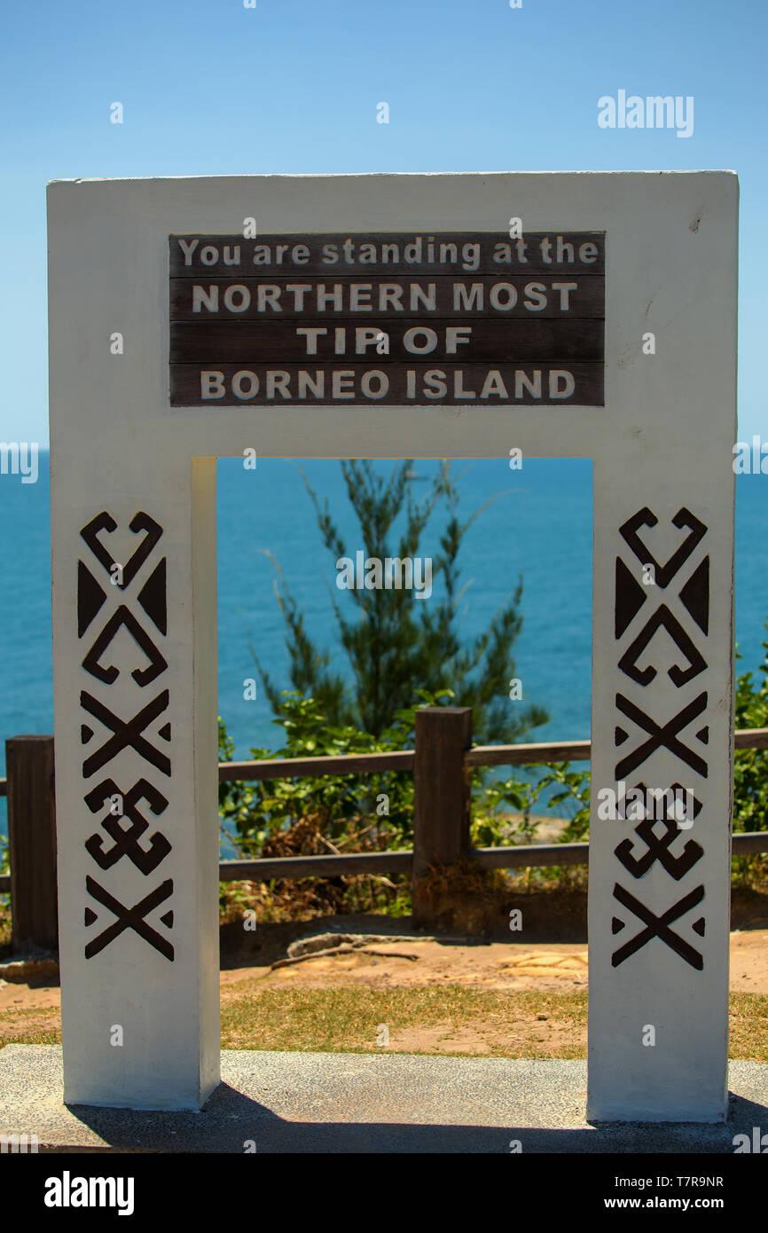 A sign reading ' You are standing at the Northern Most Tip Of Borneo Island' at Simpang Menggayau near Kudat Sabah Malaysia - Stock Image