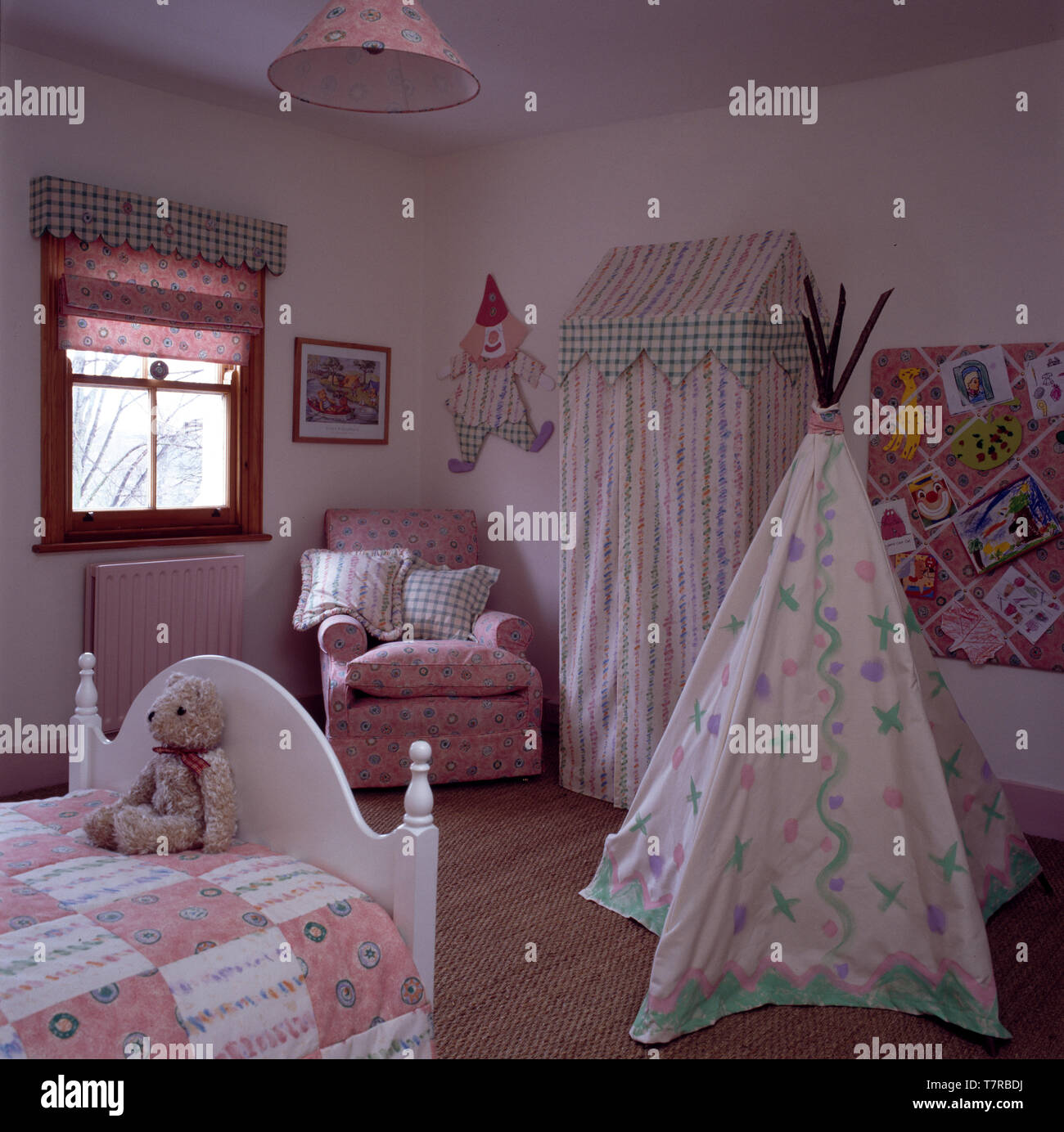 Painted wig wam and pink chair in children\'s bedroom Stock ...