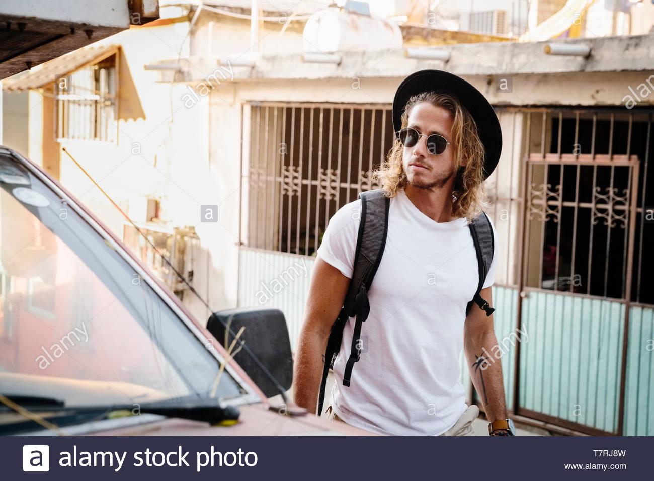 Young man walking on street, Mexico - Stock Image