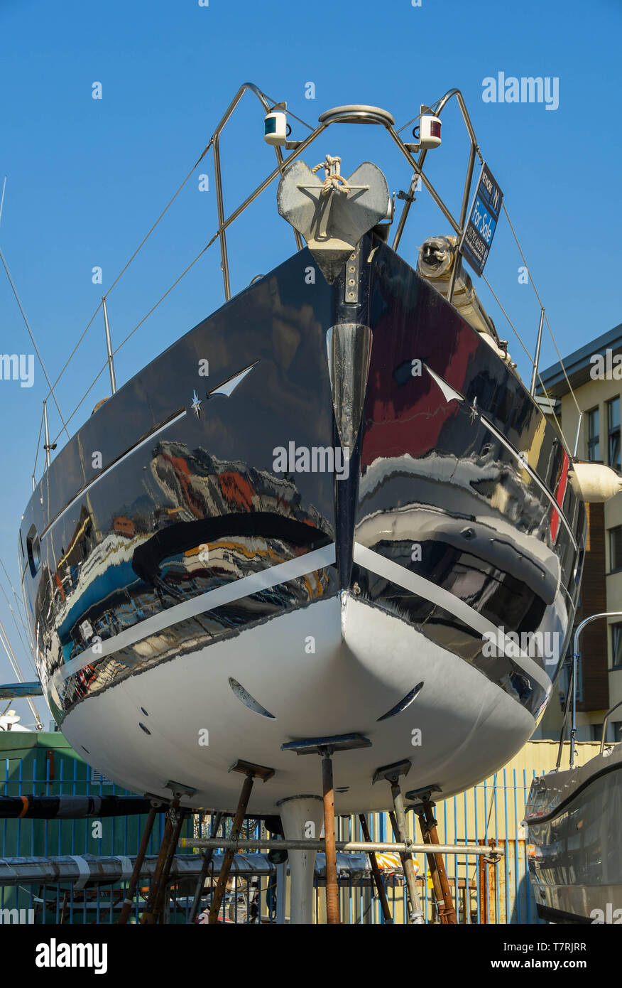 SWANSEA, WALES - JULY 2018: Racing yacht with a polished hull on sale in a boatyard in Swansea marina Stock Photo