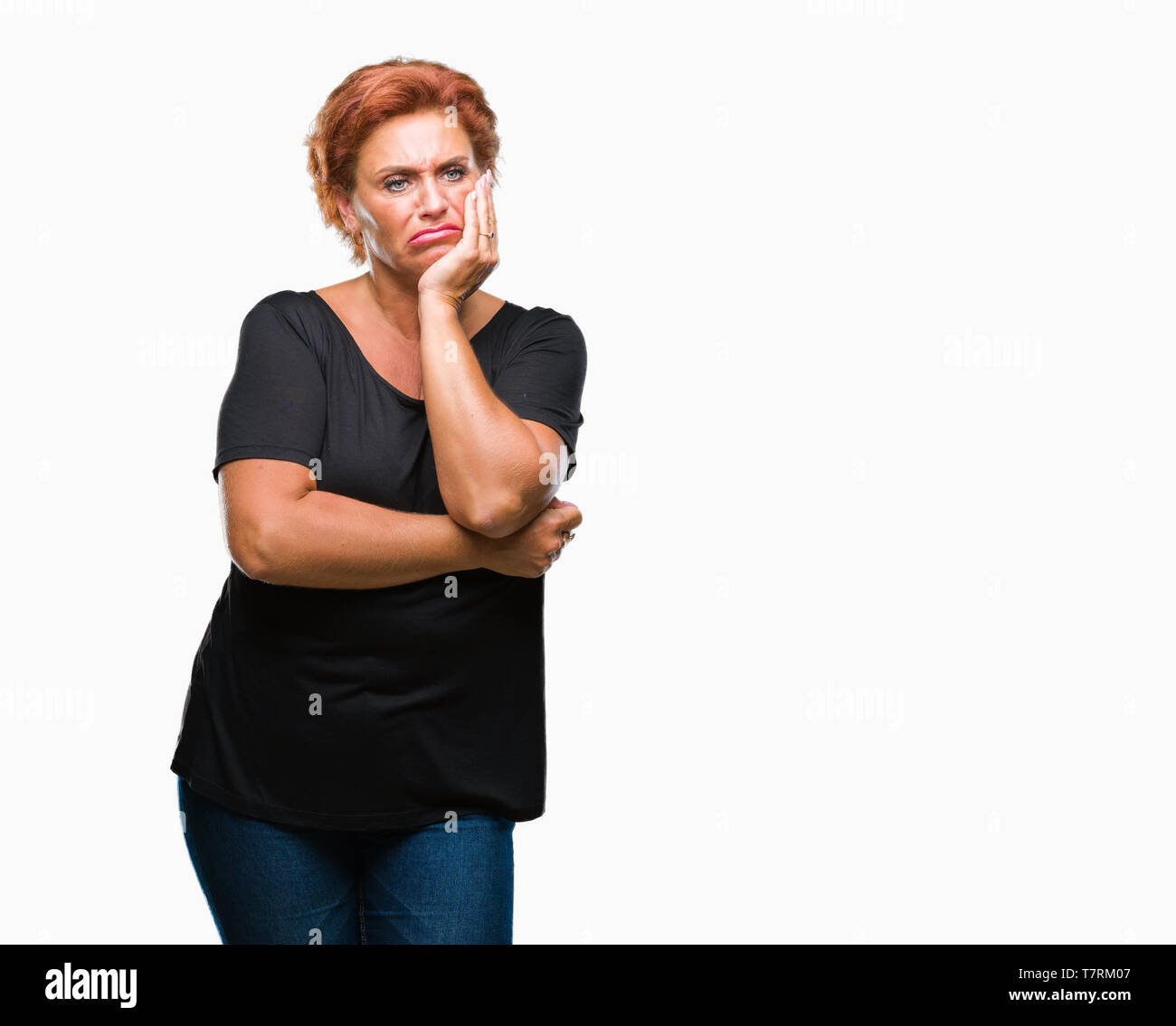 Atrractive senior caucasian redhead woman over isolated background thinking looking tired and bored with depression problems with crossed arms. Stock Photo