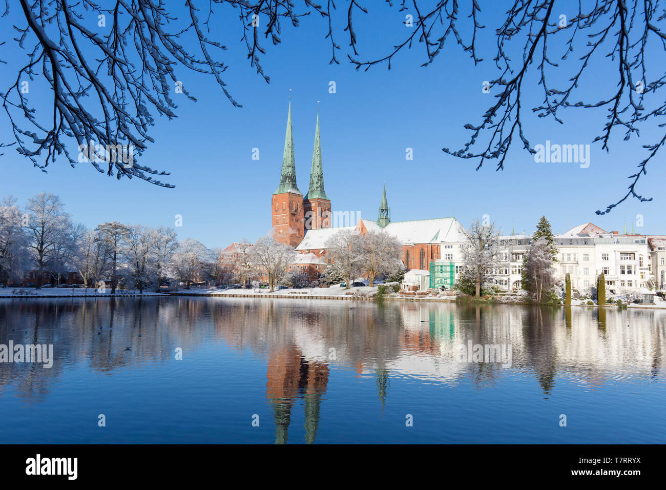 Lübeck Cathedral / Dom zu Lübeck / Lübecker Dom along the river Trave in the Hanseatic town Luebeck in winter, Schleswig-Holstein, Germany - Stock Image