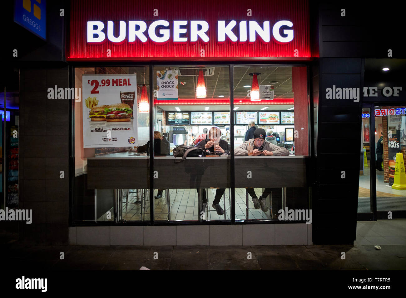 Iconic Newcastle upon Tyne lads eating in Burger King - Stock Image