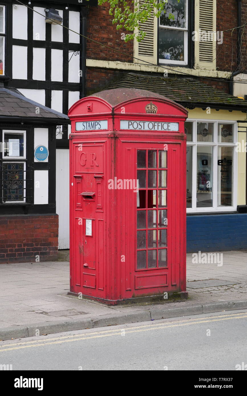 One of only four Model K4 UK telephone boxes left in public use in Frodsham, Cheshire, UK - designed in 1927 - Stock Image