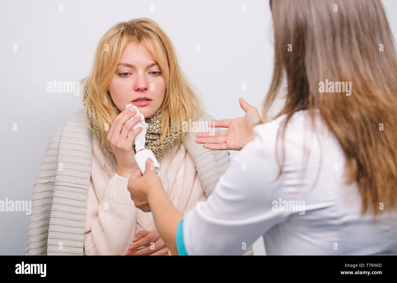 It will help her to breathe. Doctor visiting unhealthy woman at home. Medical doctor examining patient. Primary care doctor making diagnosis to sick woman. Patient care and healthcare. - Stock Image