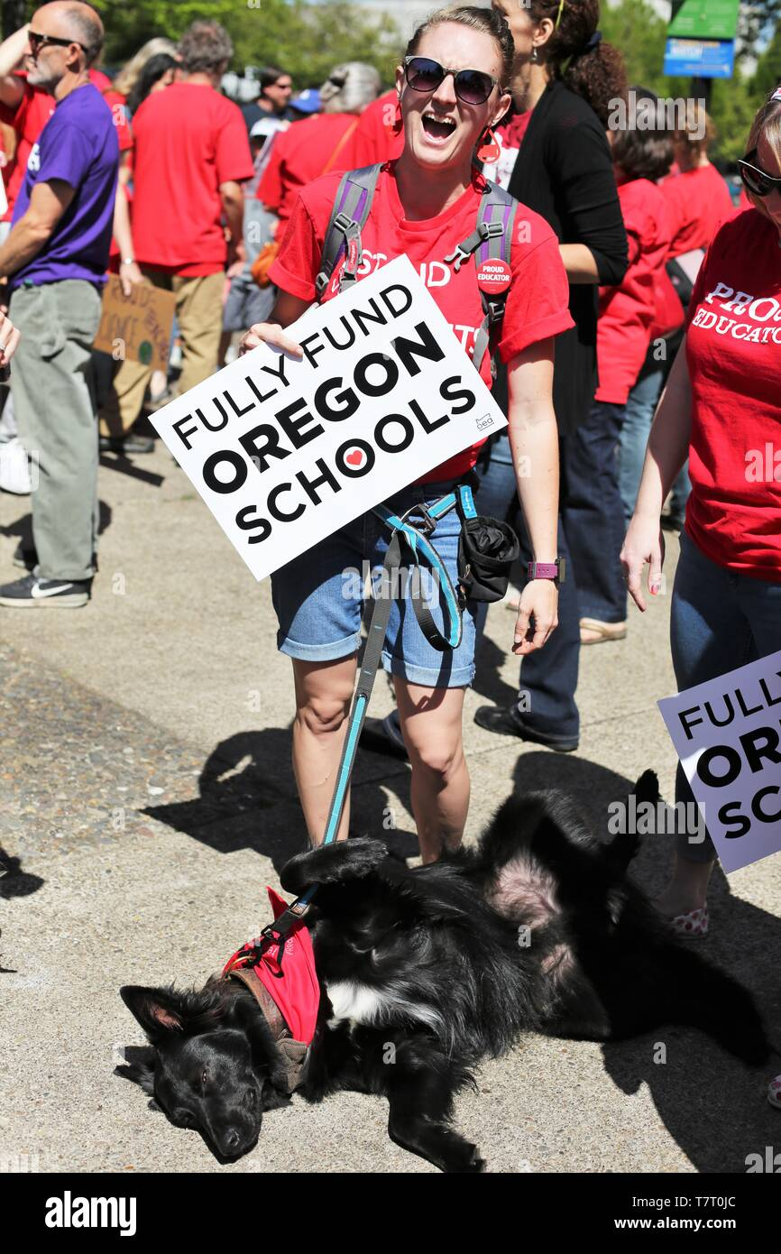 Educators and supporters gather for a rally during a Teacher Walkout in Eugene, Oregon, USA. - Stock Image