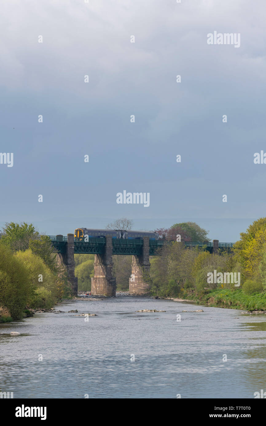 A Scotrail Commuter Train (Class 158 'Express' DMU) Crossing the River North Esk on the Marykirk Viaduct - Stock Image