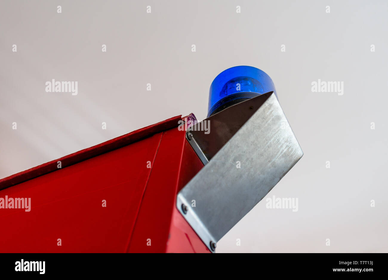 Blue warning signal placed on the back of the fire truck. Stock Photo