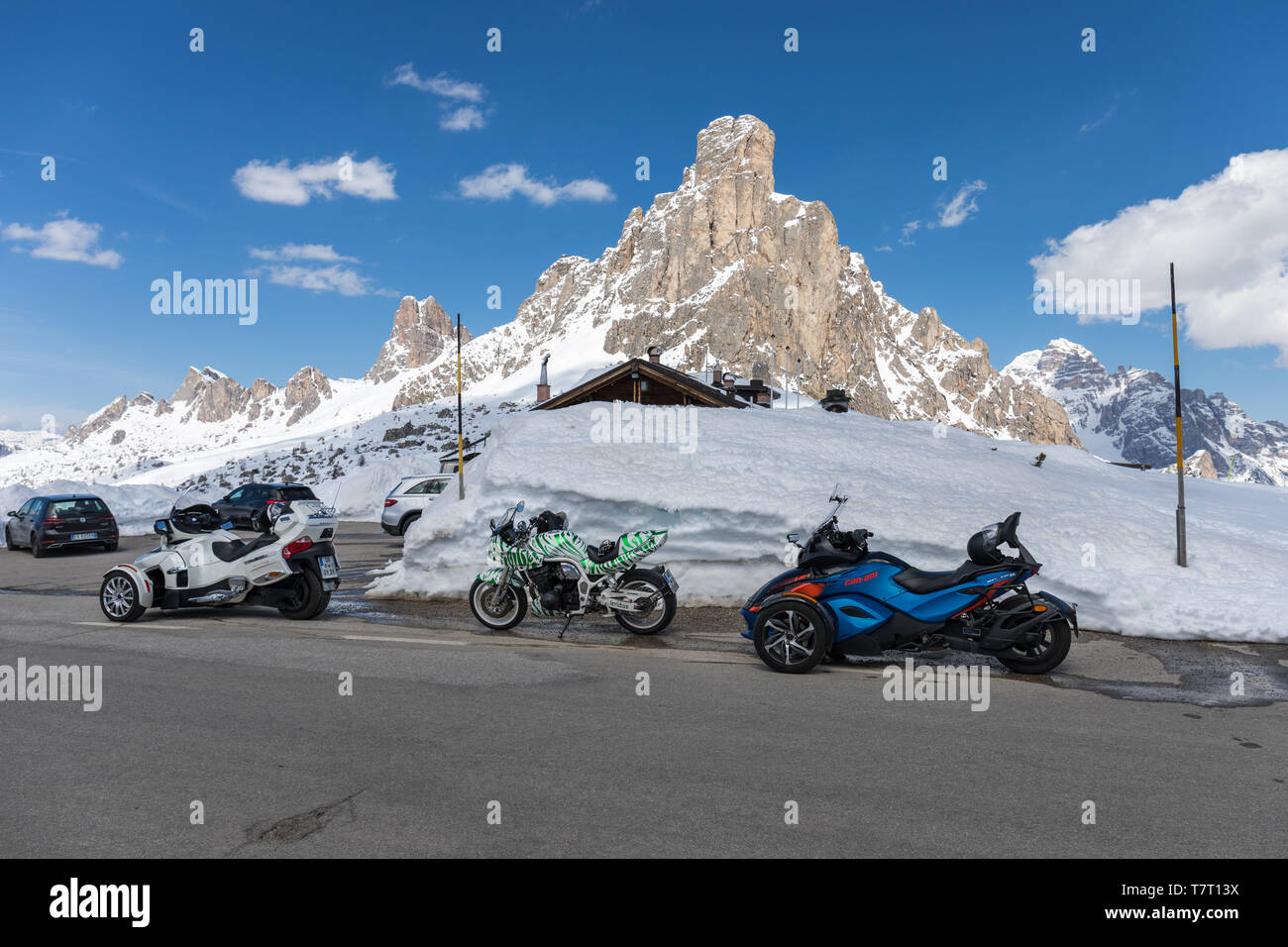Motorcycles parked at the Giau Pass, Dolomites, Italy. La Gusela mountain in the background - Stock Image