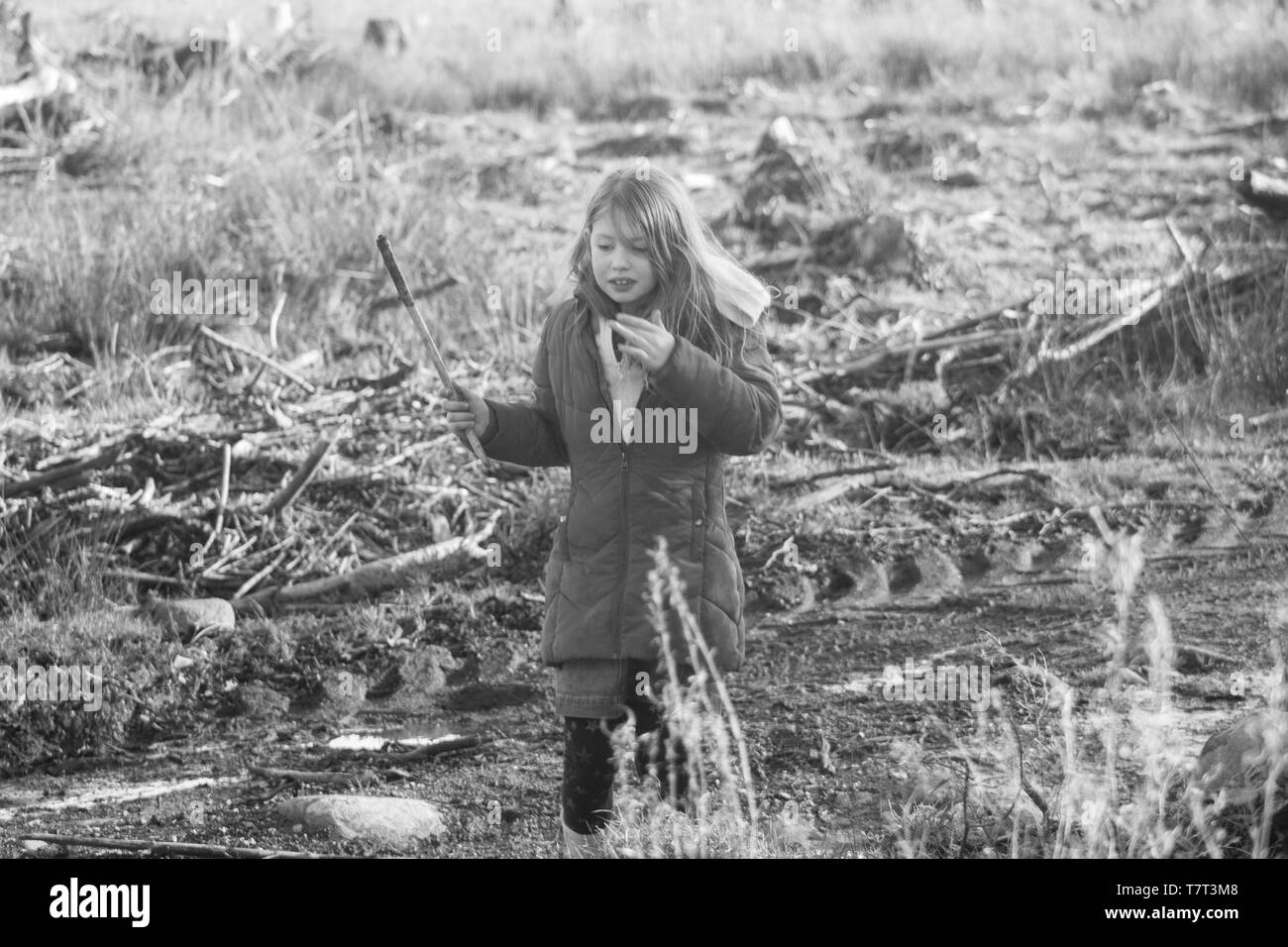 black and white girl in field - Stock Image