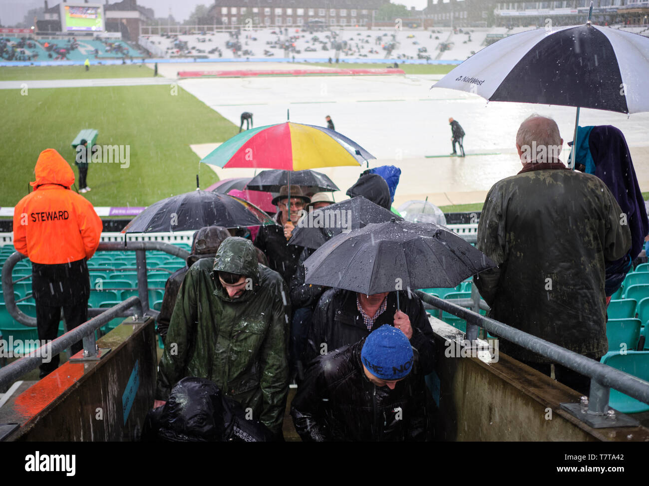 London, UK. 8th May 2019. UK Weather:  Ticket holders leave as heavy rain and hail  stops play during the first One Day International between England and Pakistan at The Kia Oval. Credit: Thomas Bowles/Alamy Live News Stock Photo