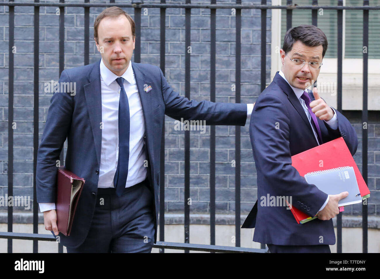 February 26, 2019 - London, UK, United Kingdom - Communities Secretary James Brokenshire (R) and Secretary of State for Health and Social Care (L) Matthew Hancock seen in Downing Street..On 14 June 2017, a fire broke out in the 24-storey Grenfell Tower block of flats in North Kensington, West London where 72 people died, more than 70 others were injured and 223 people escaped..The UK Government is to fund an estimated £200 million to replacement of unsafe Grenfell style cladding on around 170 high-rise private residential buildings after private building owners failed to take action. Communit - Stock Image