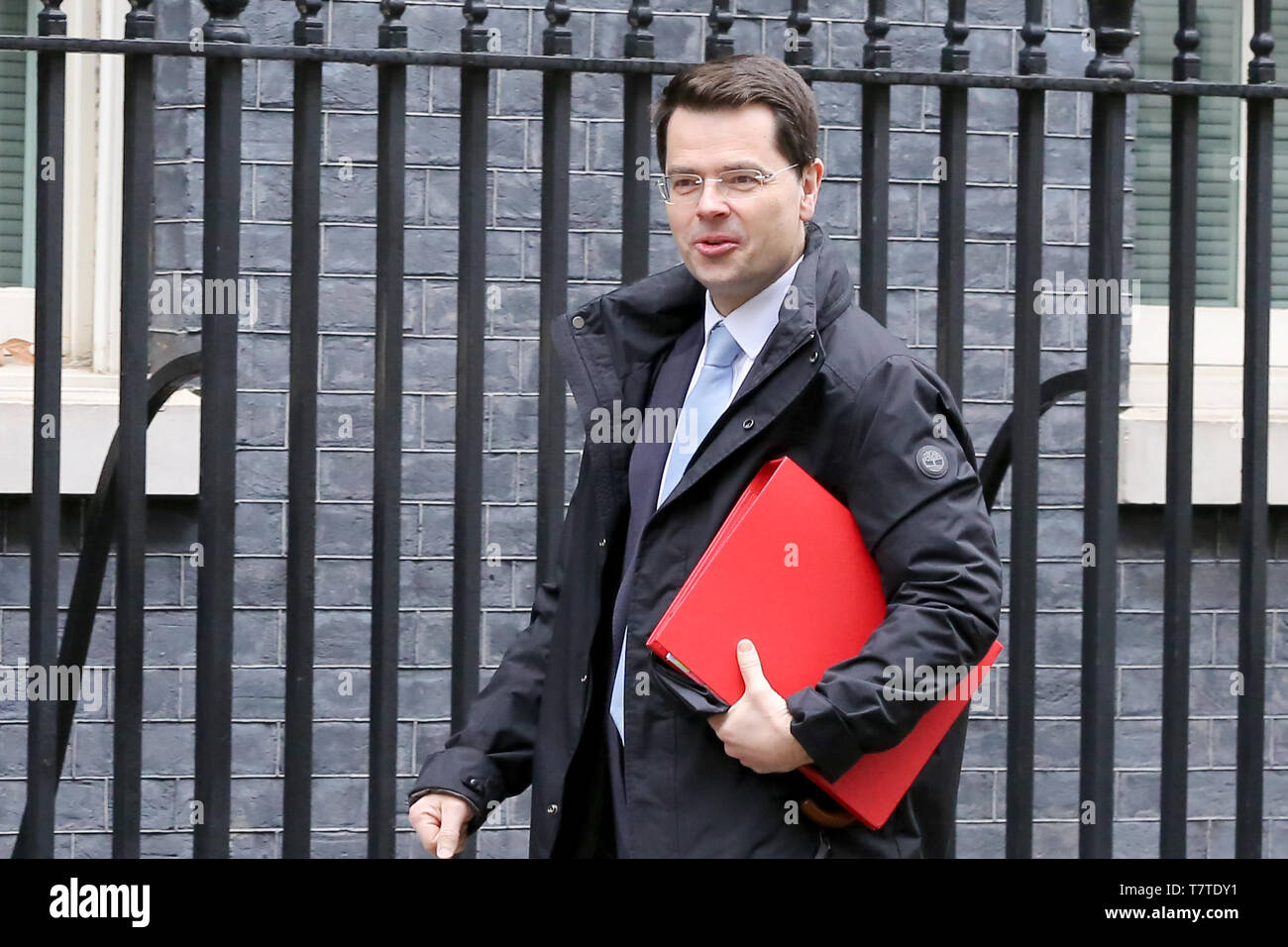 March 19, 2019 - London, UK, United Kingdom - Communities Secretary James Brokenshire seen in Downing Street..On 14 June 2017, a fire broke out in the 24-storey Grenfell Tower block of flats in North Kensington, West London where 72 people died, more than 70 others were injured and 223 people escaped..The UK Government is to fund an estimated £200 million to replacement of unsafe Grenfell style cladding on around 170 high-rise private residential buildings after private building owners failed to take action. Communities Secretary James Brokenshire said inaction from building owners had compel - Stock Image
