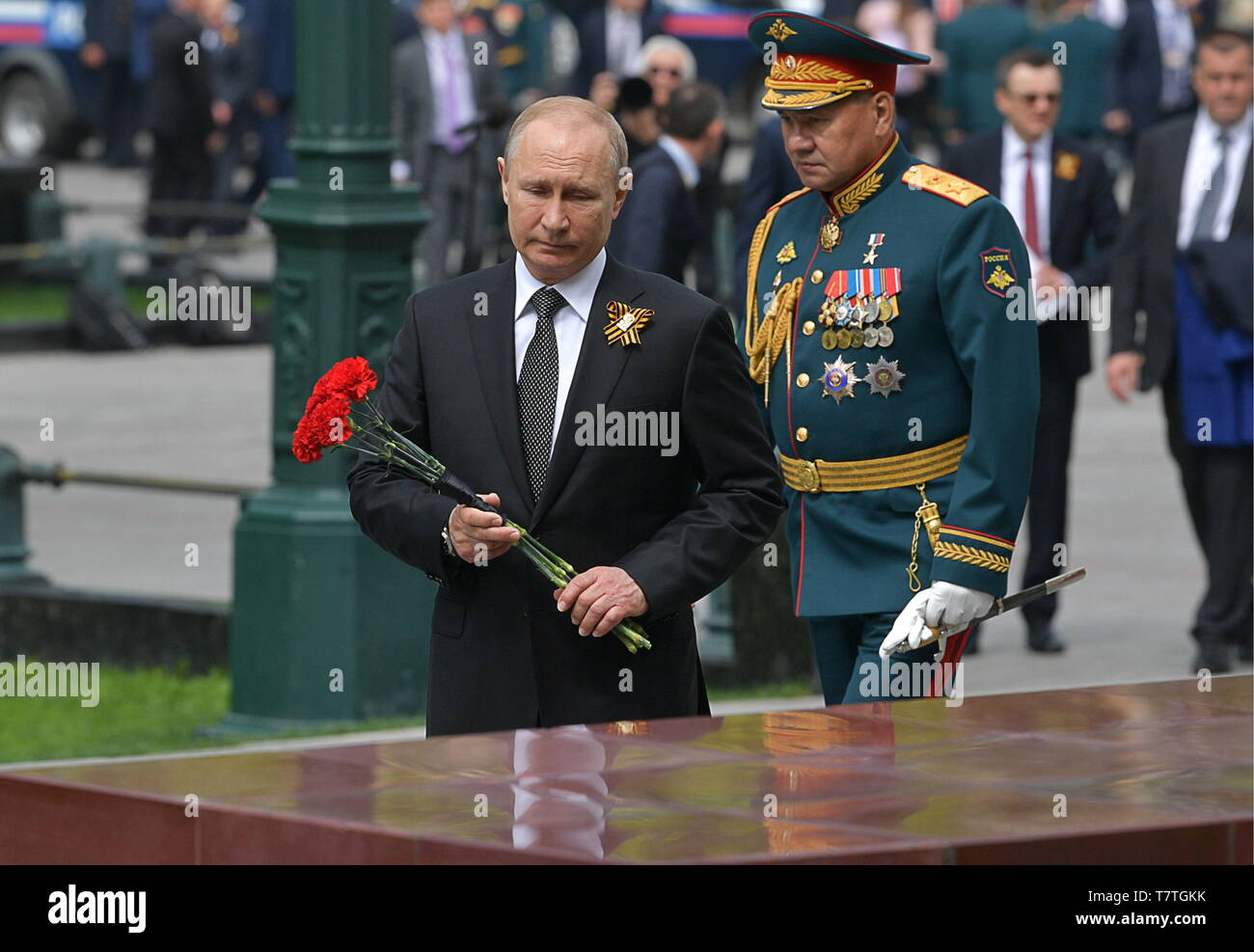 Moscow, Russia. 09th May, 2019. MOSCOW, RUSSIA - MAY 9, 2019: Russia's President Vladimir Putin (front), Russia's Defence Minister Sergei Shoigu (back) during a ceremony to lay flowers at the Tomb of the Unknown Soldier by the Kremlin Wall during celebrations marking the 74th anniversary of the victory of the Soviet Red Army over Nazi Germany in the Great Patriotic War of 1941-45, the Eastern Front of the Second World War. Alexei Druzhinin/Russian Presidential Press and Information Office/TASS Credit: ITAR-TASS News Agency/Alamy Live News - Stock Image