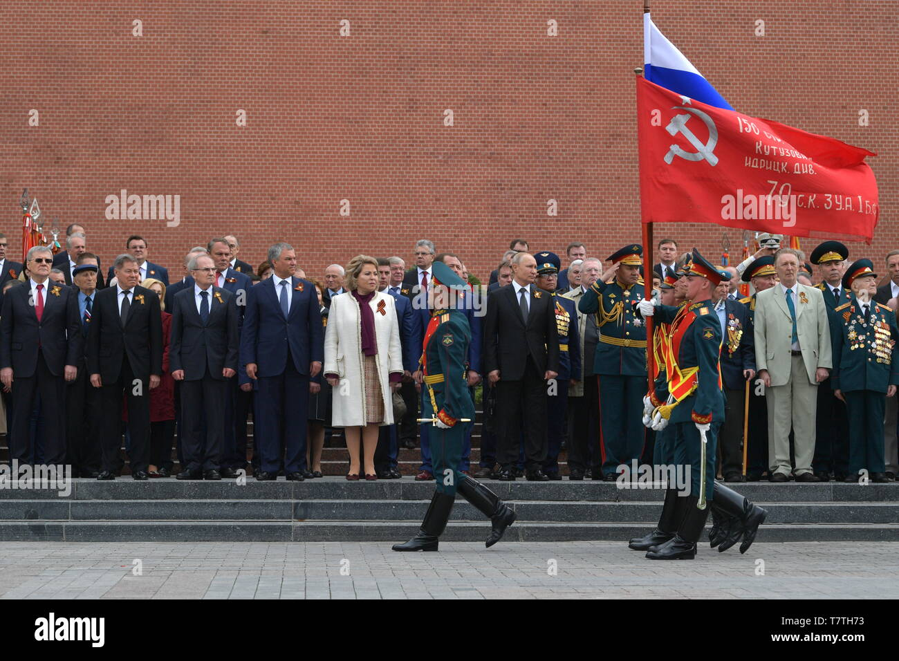 MOSCOW, RUSSIA - MAY 9, 2019: Russian Prosecutor General Yuri Chaika, Russian Supreme Court Chairman Vyacheslav Lebedev, Russian Constitutional Court Chairman Valery Zorkin, Russian State Duma Chairman Vyacheslav Volodin, Russian Federation Council Chairwoman Valentina Matviyenko, Russia's Prime Minister Dmitry Medvedev, Russia's President Vladimir Putin, Russia's Defence Minister Sergei Shoigu (L-R back) during a ceremony to lay flowers at the Tomb of the Unknown Soldier by the Kremlin Wall during celebrations marking the 74th anniversary of the victory of the Soviet Red Army over Nazi German - Stock Image
