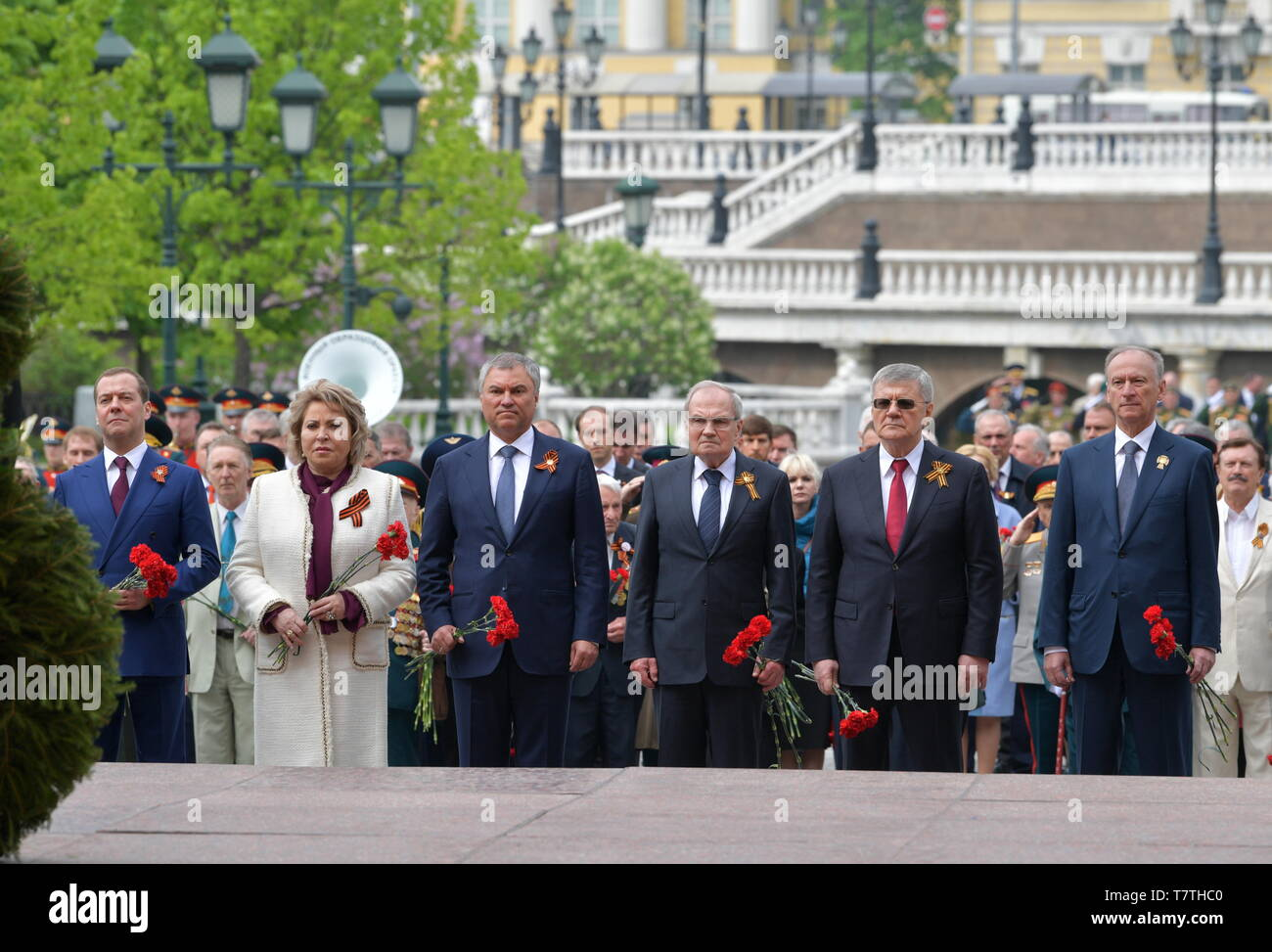 MOSCOW, RUSSIA - MAY 9, 2019: Russia's Prime Minister Dmitry Medvedev, Russian Federation Council Chairwoman Valentina Matviyenko, Russian State Duma Chairman Vyacheslav Volodin, Russian Constitutional Court Chairman Valery Zorkin, Russian Prosecutor General Yuri Chaika, Russia's President Vladimir Putin, and Russian Security Council Secretary Nikolai Patrushev (L-R) during a ceremony to lay flowers at the Tomb of the Unknown Soldier by the Kremlin Wall during celebrations marking the 74th anniversary of the victory of the Soviet Red Army over Nazi Germany in the Great Patriotic War of 1941-45 - Stock Image