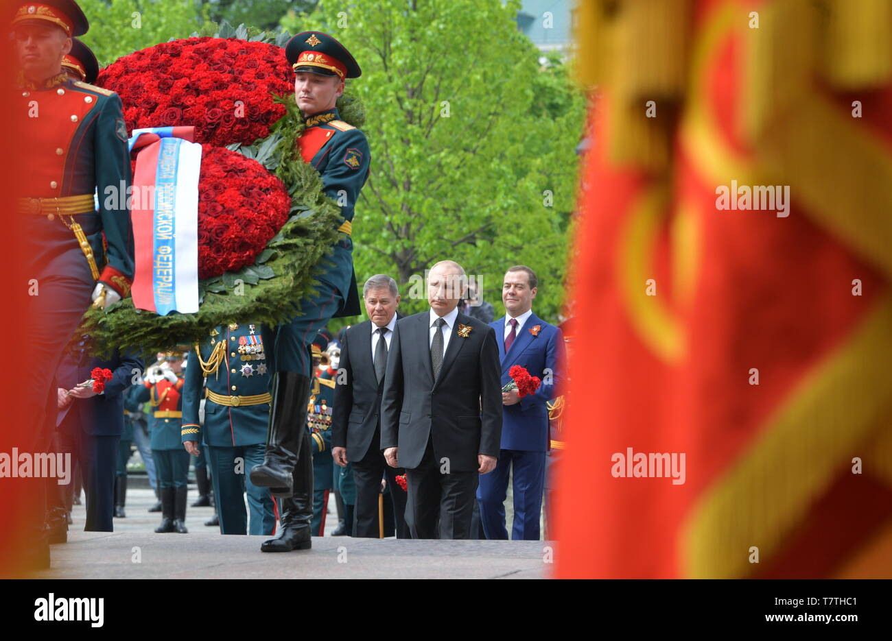 Moscow, Russia. 09th May, 2019. MOSCOW, RUSSIA - MAY 9, 2019: Russia's President Vladimir Putin (C), Russian Supreme Court Chairman Vyacheslav Lebedev, and Russia's Prime Minister Dmitry Medvedev (L-R back) during a ceremony to lay flowers at the Tomb of the Unknown Soldier by the Kremlin Wall during celebrations marking the 74th anniversary of the victory of the Soviet Red Army over Nazi Germany in the Great Patriotic War of 1941-45, the Eastern Front of the Second World War. Alexei Druzhinin/Russian Presidential Press and Information Office/TASS Credit: ITAR-TASS News Agency/Alamy Live News - Stock Image