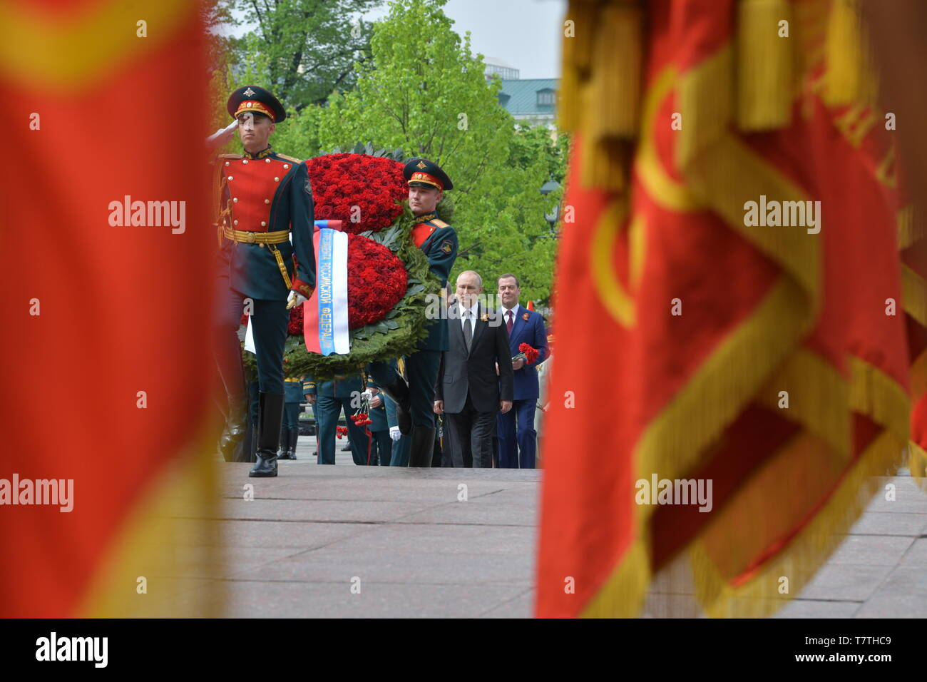 Moscow, Russia. 09th May, 2019. MOSCOW, RUSSIA - MAY 9, 2019: Russia's President Vladimir Putin and Russia's Prime Minister Dmitry Medvedev (L-R centre) during a ceremony to lay flowers at the Tomb of the Unknown Soldier by the Kremlin Wall during celebrations marking the 74th anniversary of the victory of the Soviet Red Army over Nazi Germany in the Great Patriotic War of 1941-45, the Eastern Front of the Second World War. Alexei Druzhinin/Russian Presidential Press and Information Office/TASS Credit: ITAR-TASS News Agency/Alamy Live News - Stock Image