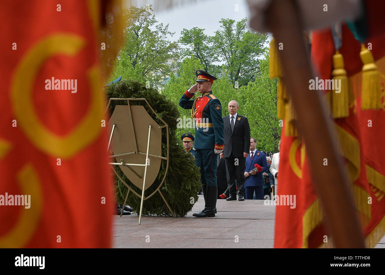 Moscow, Russia. 09th May, 2019. MOSCOW, RUSSIA - MAY 9, 2019: Russia's President Vladimir Putin (C), Russia's Defence Minister Sergei Shoigu and Russia's Prime Minister Dmitry Medvedev (L-R back) during a ceremony to lay flowers at the Tomb of the Unknown Soldier by the Kremlin Wall during celebrations marking the 74th anniversary of the victory of the Soviet Red Army over Nazi Germany in the Great Patriotic War of 1941-45, the Eastern Front of the Second World War. Alexei Druzhinin/Russian Presidential Press and Information Office/TASS Credit: ITAR-TASS News Agency/Alamy Live News - Stock Image