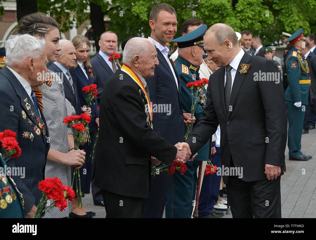Moscow, Russia. 09th May, 2019. MOSCOW, RUSSIA - MAY 9, 2019: Russia's President Vladimir Putin (R) greets WWII veterans ahead of a ceremony to lay flowers at the Tomb of the Unknown Soldier by the Kremlin Wall during celebrations marking the 74th anniversary of the victory of the Soviet Red Army over Nazi Germany in the Great Patriotic War of 1941-45, the Eastern Front of the Second World War. Alexei Druzhinin/Russian Presidential Press and Information Office/TASS Credit: ITAR-TASS News Agency/Alamy Live News - Stock Image