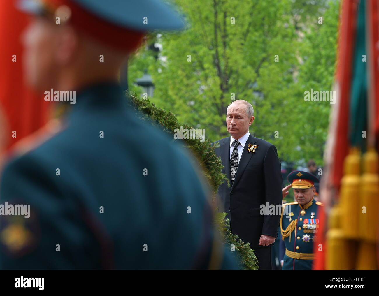 Moscow, Russia. 09th May, 2019. MOSCOW, RUSSIA - MAY 9, 2019: Russia's President Vladimir Putin and Russia's Defence Minister Sergei Shoigu (L-R centre) during a ceremony to lay flowers at the Tomb of the Unknown Soldier by the Kremlin Wall during celebrations marking the 74th anniversary of the victory of the Soviet Red Army over Nazi Germany in the Great Patriotic War of 1941-45, the Eastern Front of the Second World War. Alexei Druzhinin/Russian Presidential Press and Information Office/TASS Credit: ITAR-TASS News Agency/Alamy Live News - Stock Image