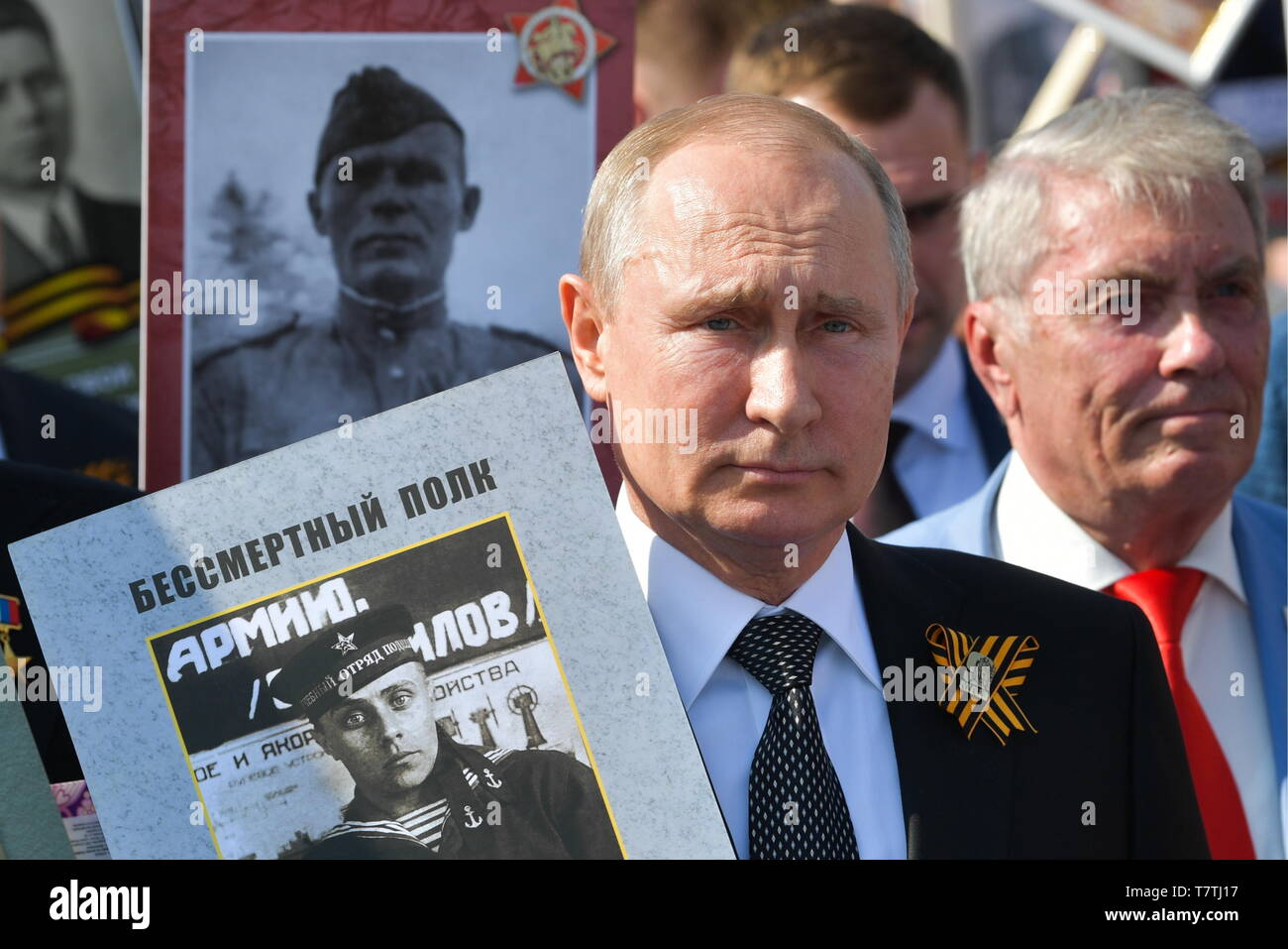 Moscow, Russia. 09th May, 2019. MOSCOW, RUSSIA - MAY 9, 2019: Russia's President Vladimir Putin (front) carries a portrait of his father Vladimir Spiridonovich Putin (1911-1998), who fought in World War II, as he takes part in the Immortal Regiment march in Red Square to mark the 74th anniversary of the Victory over Nazi Germany in the Great Patriotic War, the Eastern Front of World War II. Alexei Druzhinin/Russian Presidential Press and Informationa Office/TASS Credit: ITAR-TASS News Agency/Alamy Live News - Stock Image