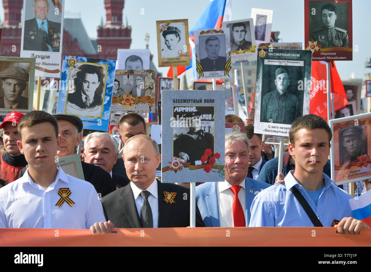 Moscow, Russia. 09th May, 2019. MOSCOW, RUSSIA - MAY 9, 2019: Russia's President Vladimir Putin (2nd L front) carries a portrait of his father Vladimir Spiridonovich Putin (1911-1998), who fought in World War II, as he takes part in the Immortal Regiment march in Red Square to mark the 74th anniversary of the Victory over Nazi Germany in the Great Patriotic War, the Eastern Front of World War II. Alexei Druzhinin/Russian Presidential Press and Informationa Office/TASS Credit: ITAR-TASS News Agency/Alamy Live News - Stock Image