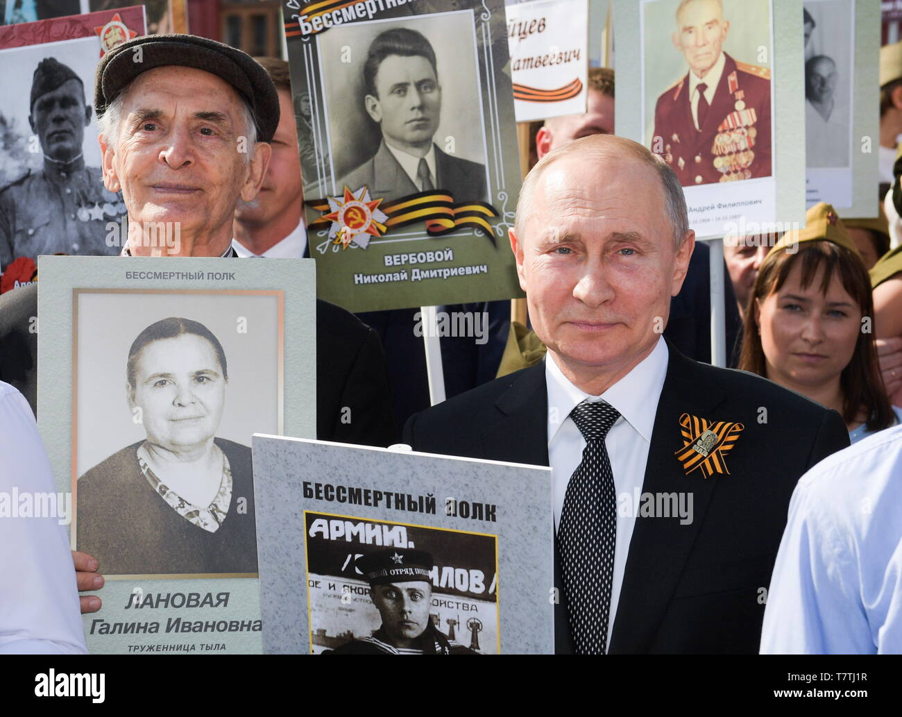 Moscow, Russia. 09th May, 2019. MOSCOW, RUSSIA - MAY 9, 2019: Actor Vasily Lanovoy and Russia's President Vladimir Putin (L-R front) carry portraits of their relatives who fought in World War II as they take part in the Immortal Regiment march in Red Square to mark the 74th anniversary of the Victory over Nazi Germany in the Great Patriotic War, the Eastern Front of World War II. Alexei Druzhinin/Russian Presidential Press and Informationa Office/TASS Credit: ITAR-TASS News Agency/Alamy Live News - Stock Image