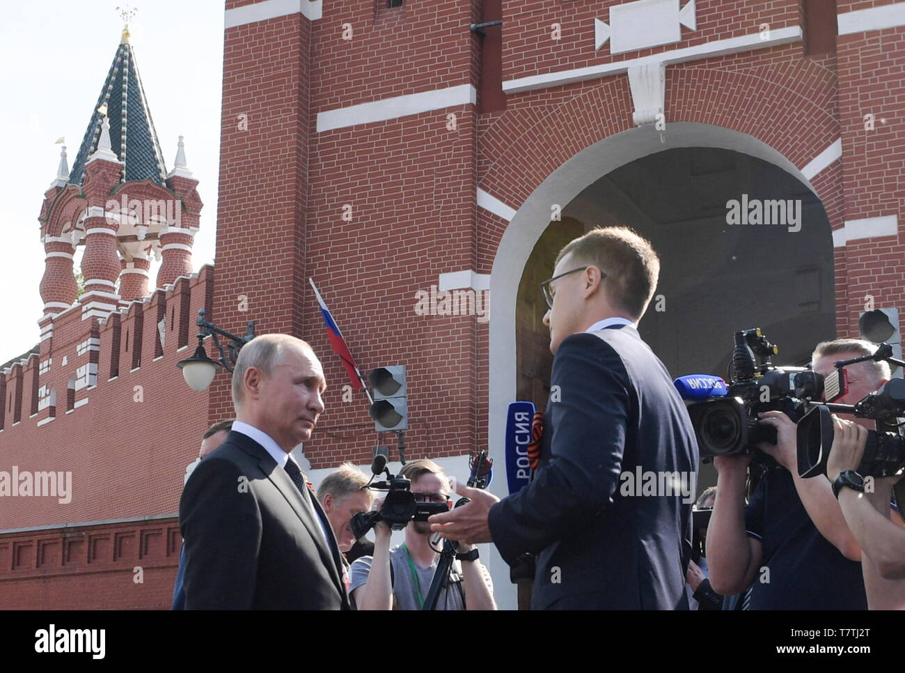 Moscow, Russia. 09th May, 2019. MOSCOW, RUSSIA - MAY 9, 2019: Russia's President Vladimir Putin (L) interviewed in Red Square after the Immortal Regiment march marking the 74th anniversary of the Victory over Nazi Germany in the Great Patriotic War, the Eastern Front of World War II. Alexei Druzhinin/Russian Presidential Press and Information Office/TASS Credit: ITAR-TASS News Agency/Alamy Live News - Stock Image