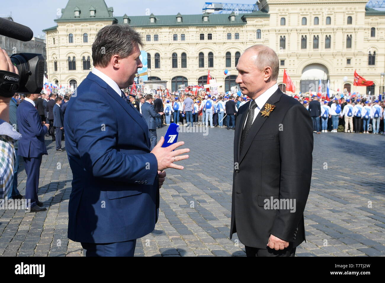 Moscow, Russia. 09th May, 2019. MOSCOW, RUSSIA - MAY 9, 2019: Russia's President Vladimir Putin (R) interviewed by a Channel One journalist in Red Square after the Immortal Regiment march marking the 74th anniversary of the Victory over Nazi Germany in the Great Patriotic War, the Eastern Front of World War II. Alexei Druzhinin/Russian Presidential Press and Information Office/TASS Credit: ITAR-TASS News Agency/Alamy Live News - Stock Image