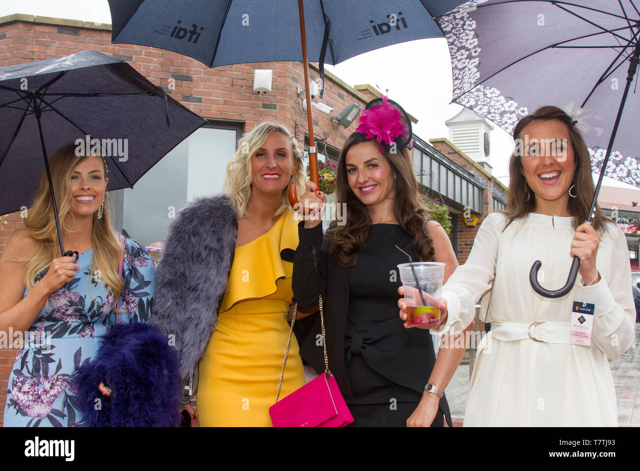 Chester, UK. 9th May, 2019 Boodles May Festival. The famous horse racing event welcomes fashionistas & street style people on this very special parade of the finest expensive female fashions. Glamorous racegoers women in fancy outfits, ladies in figure-hugging suits, floral dresses, lovely, charming, elegant, splendid, impressive, magnificent, prestigious fashionable frocks, plush opulent, ritzy patrons, lovely, charming, elegant, splendid hats, headbands & fashion finery wearing high end couture attend Chester Races. Credit. MWI/AlamyLiveNews - Stock Image
