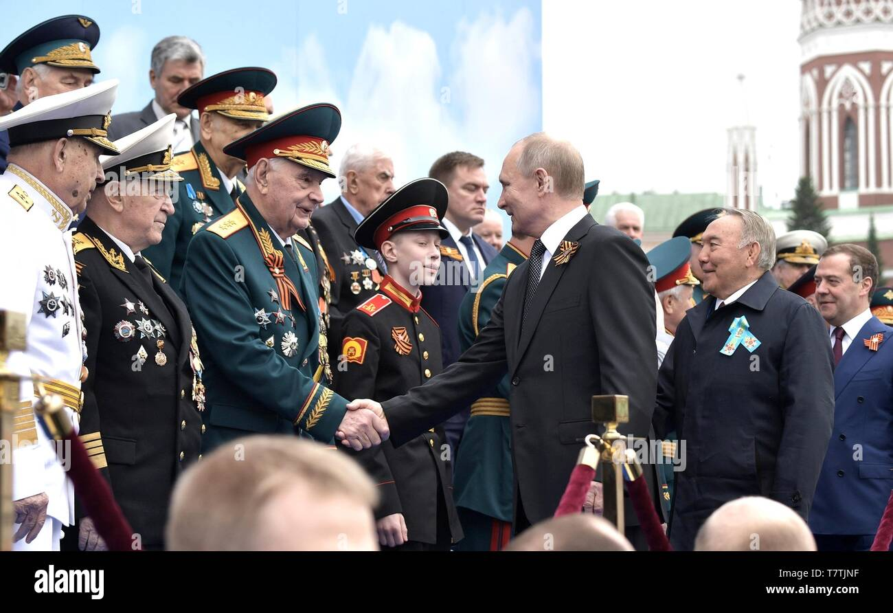 Moscow, Russia. 09th May, 2019. Russian President Vladimir Putin greets veterans before the start of the annual Victory Day military parade marking the 74th anniversary of the end of World War II in Red Square May 9, 2019 in Moscow, Russia. Russia celebrates the annual event known as the Victory in the Great Patriotic War with parades and a national address by President Vladimir Putin. Credit: Planetpix/Alamy Live News - Stock Image