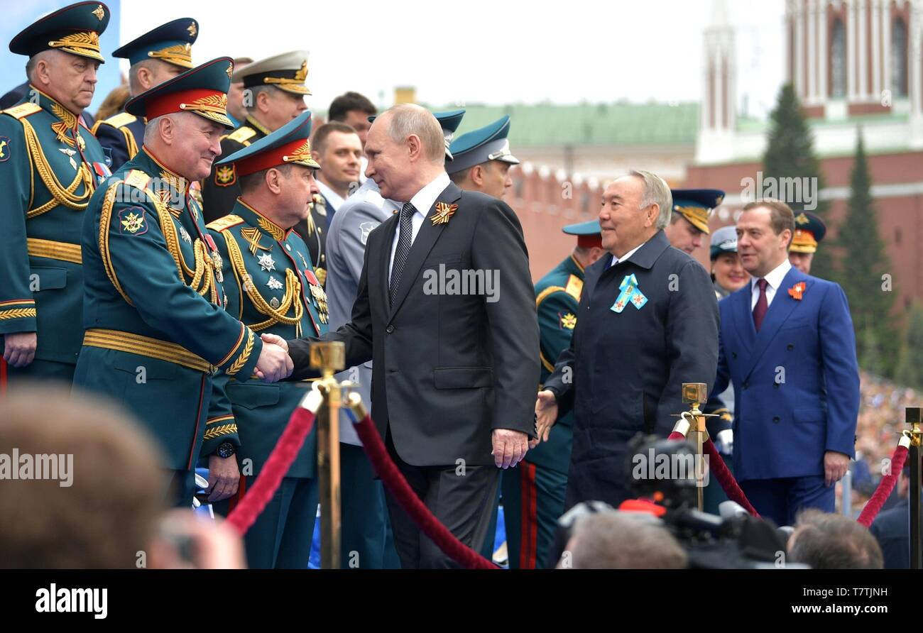 Moscow, Russia. 09th May, 2019. Russian President Vladimir Putin greets military leaders before the start of the annual Victory Day military parade marking the 74th anniversary of the end of World War II in Red Square May 9, 2019 in Moscow, Russia. Russia celebrates the annual event known as the Victory in the Great Patriotic War with parades and a national address by President Vladimir Putin. Credit: Planetpix/Alamy Live News - Stock Image