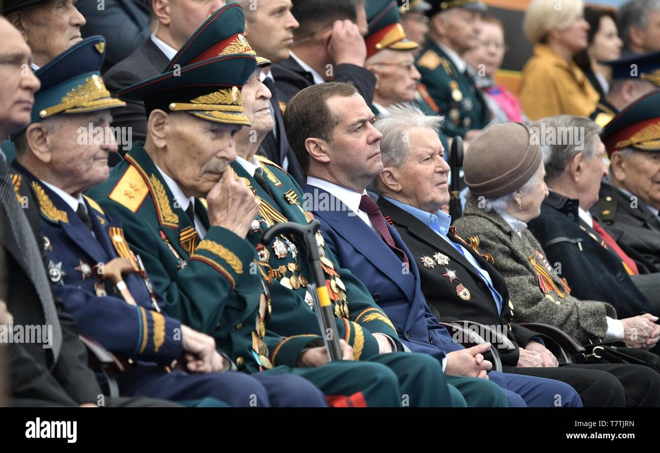 Moscow, Russia. 09th May, 2019. Russian Prime Minister Dmitry Medvedev, center, during the review of troops at the annual Victory Day military parade marking the 74th anniversary of the end of World War II in Red Square May 9, 2019 in Moscow, Russia. Russia celebrates the annual event known as the Victory in the Great Patriotic War with parades and a national address by President Vladimir Putin. Credit: Planetpix/Alamy Live News - Stock Image
