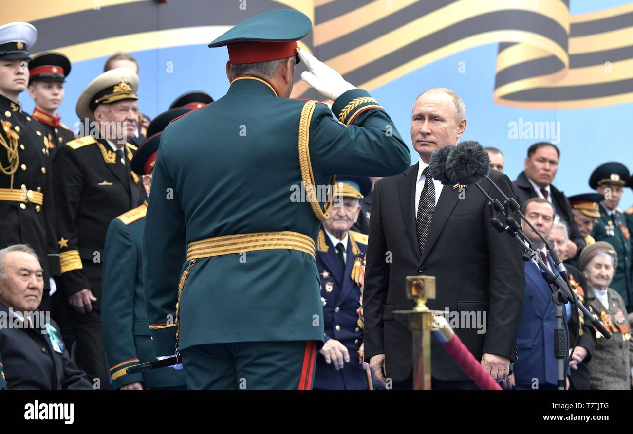 Moscow, Russia. 09th May, 2019. Russian President Vladimir Putin, right, is saluted by Defence Minister Sergei Shoigu, left, at the start of the annual Victory Day military parade marking the 74th anniversary of the end of World War II in Red Square May 9, 2019 in Moscow, Russia. Russia celebrates the annual event known as the Victory in the Great Patriotic War with parades and a national address by President Vladimir Putin. Credit: Planetpix/Alamy Live News - Stock Image