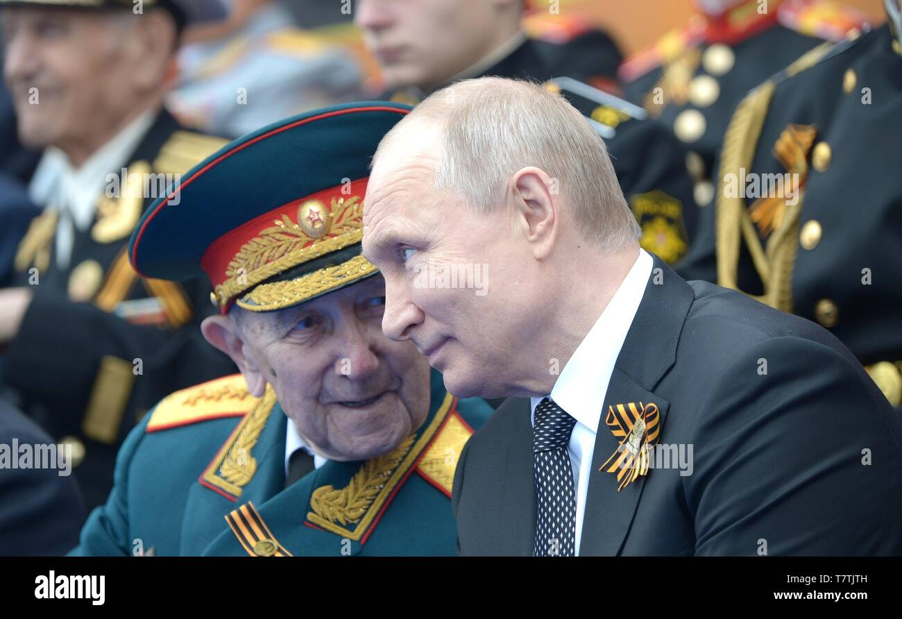 Moscow, Russia. 09th May, 2019. Russian President Vladimir Putin chats with a veteran during the review of troops at the annual Victory Day military parade marking the 74th anniversary of the end of World War II in Red Square May 9, 2019 in Moscow, Russia. Russia celebrates the annual event known as the Victory in the Great Patriotic War with parades and a national address by President Vladimir Putin. Credit: Planetpix/Alamy Live News - Stock Image
