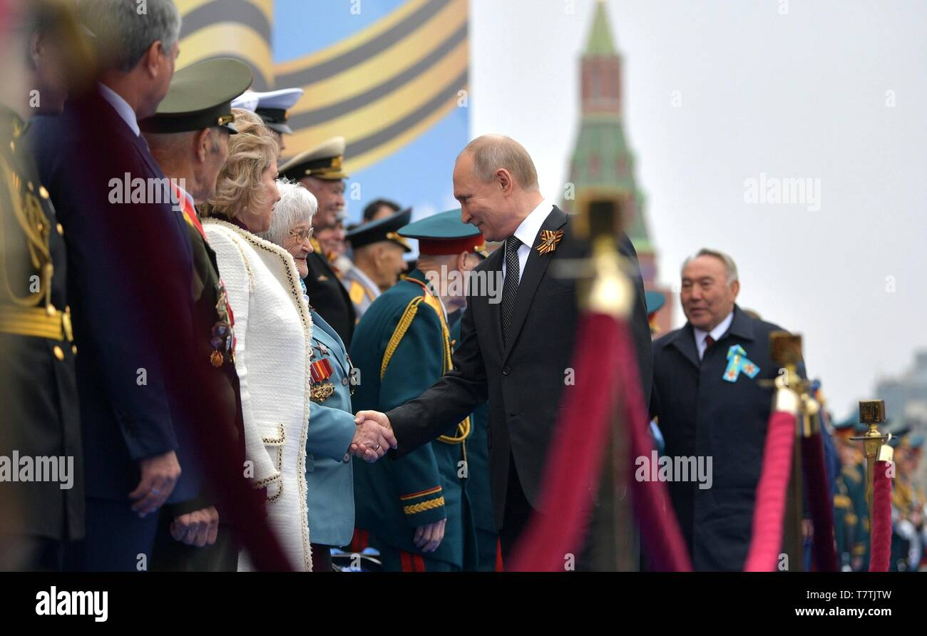 Moscow, Russia. 09th May, 2019. Russian President Vladimir Putin greets veterans and guests at the annual Victory Day military parade marking the 74th anniversary of the end of World War II in Red Square May 9, 2019 in Moscow, Russia. Russia celebrates the annual event known as the Victory in the Great Patriotic War with parades and a national address by President Vladimir Putin. Credit: Planetpix/Alamy Live News - Stock Image